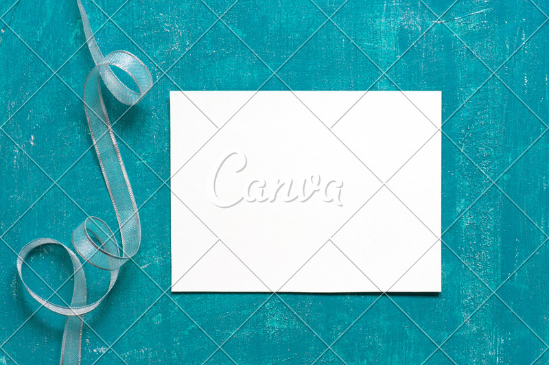Painted Aged Blue Background with Blank Sheet of Paper - Photos by Canva