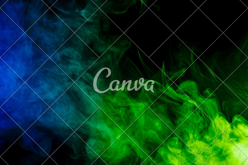 Abstract Blue and Green Smoke Hookah on a Black Background - Photos