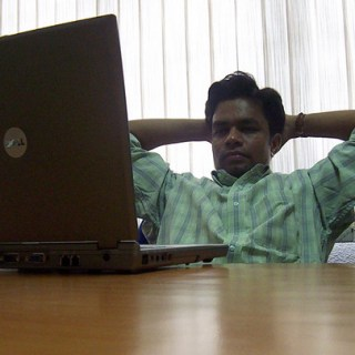 A man watching a laptop computer
