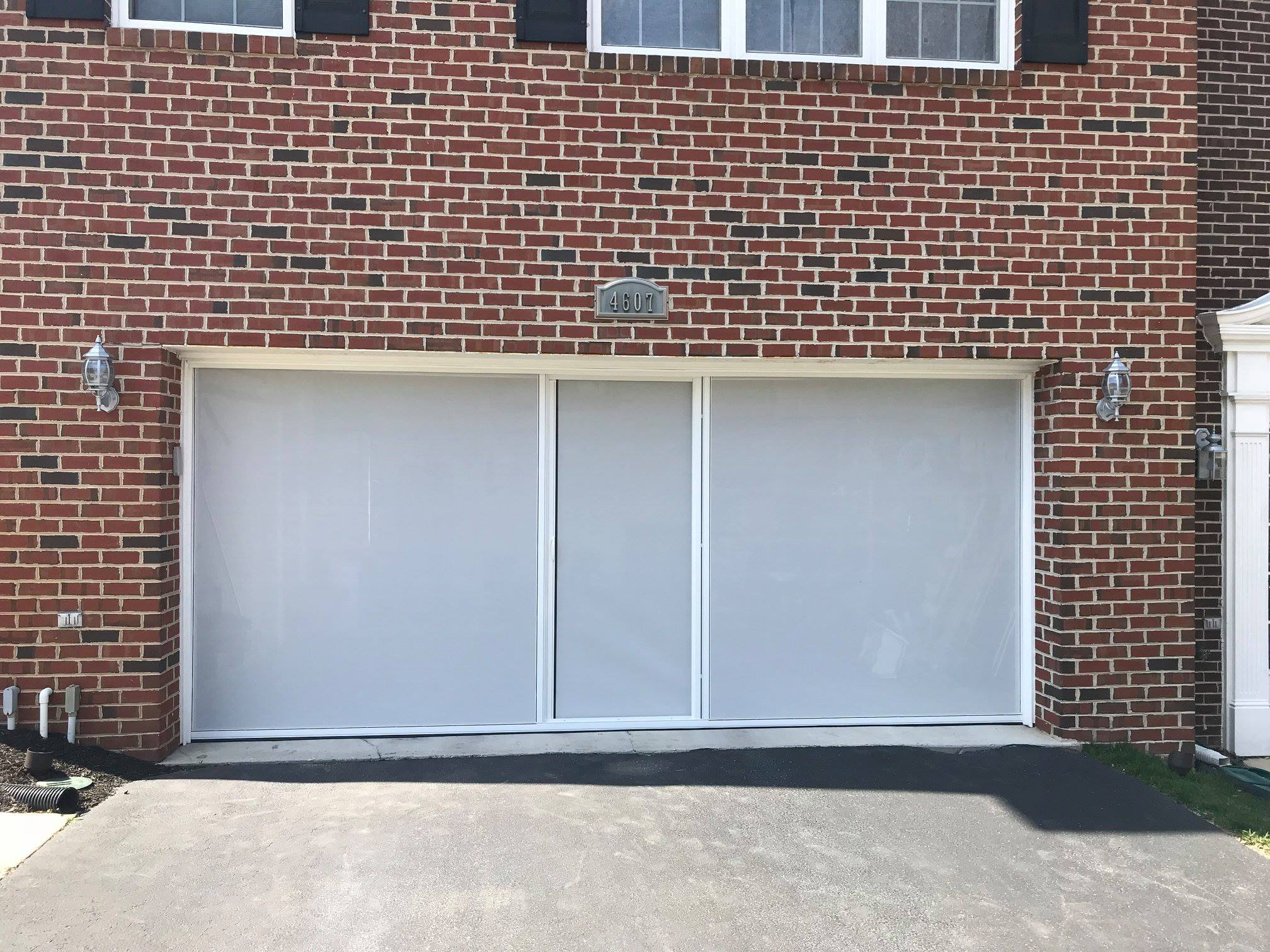 Garage Door Screen That Rolls Up Garage Door Screens Expand Your Living Space Maryland Screens