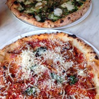 pesto pizza up top, sausage pepper with pecorino below
