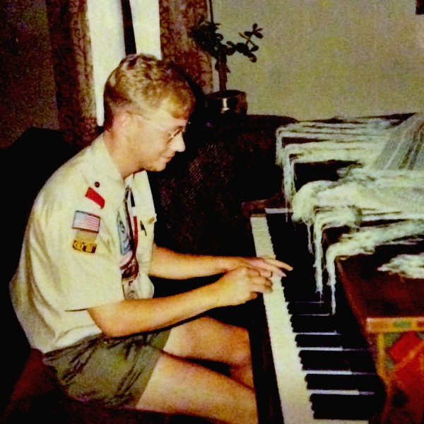 David Rinehart playing the grand piano at the Villa Philmonte at Philmont Scout Ranch, 1990