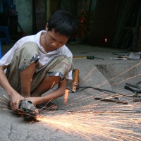 Boy working and sparks
