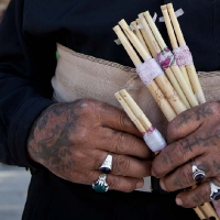 Kurdish flute seller with tattoos