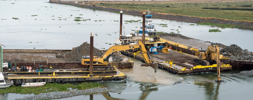 Construction crews work on removing the temporary emergency drought barrier in the delta located in the West False River area on October 1st, 2015.