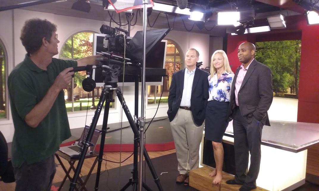 Behind the Scenes — University of Alabama Professors Andrew Billings, Kim Bissell, and Kenon Brown teach online courses for Olympic athletes on how to work with media as Preston Sullivan records in the studios of WVUA 23 TV. The courses were produced and directed by Max Shores with executive producers Amy Martin for the University of Alabama Center for Public Television and James Finn for the International Olympic Committee.