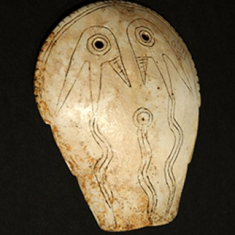 Shell Gorget (mask) with Weeping Eye Motif, Late Mississippian period, ca. AD 1450. Height 5.1 in.