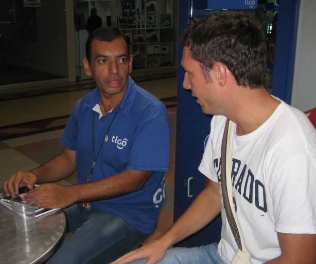 Kevin, my roommate, talking to a Tigo salesman