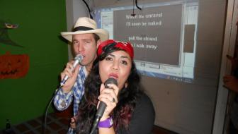 Brent and Gisela rock the mic on karaoke night.