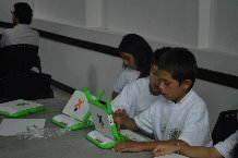 Kids with laptops at the foundation