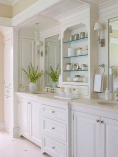White Bathroom - marble, the open shelving cabinet on top of the vanity is lovely storage
