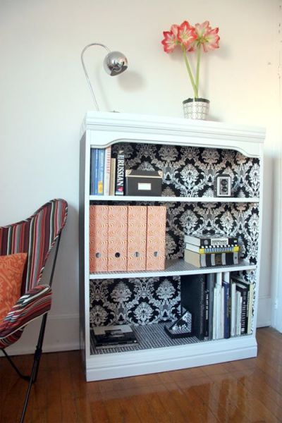 Bed Room Photos: wallpaper the inside of a bookshelf. This is on my to do list