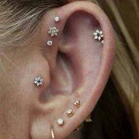 Earrings // multiple ear piercings | Tattoos | Pinterest