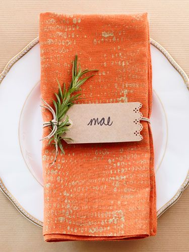 To create this gilded upgrade, dip a corncob in gold paint, then roll it onto a basic linen napkin—it's that easy!