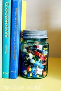 mason jar bookend with old toys | Living Room | Pinterest