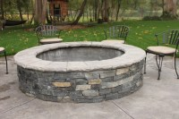 Stone fire pit on concrete patio. | Stone Patios & Fire ...