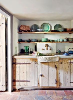 Rome apartment kitchen of pianists Katia and Marielle Labèque (the cabinet is made of reclaimed 17th-century wood) by Axel Vervoordt