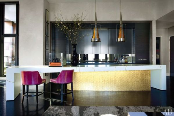 The centerpiece of Jamie Drake's Manhattan kitchen is a custom-made island comprising cabinetry finished in gold leaf by the Alpha Workshops and an overlapping table in Corian with gold inlay by Orion R|E|D Inc.