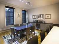 Dining Room With Track Lighting and Wine Bar