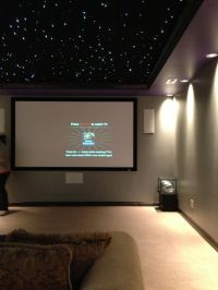 Basement media room with black ceiling.