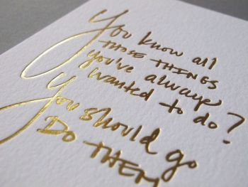 If shine is what you seek, then the gold you want is foil pressed into the paper just as ink would be–and the result is a traditional shimmer. (It does cost a wee bit more than ink.) Note that foil is available in many different colors, including white, which is the best way to get a nice opacity on black or dark paper.