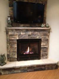 Corner-fireplace with TV mounted above   fireplaces ...
