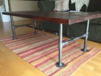 Rustic chic coffee table made with gunmetal plumbing pipes