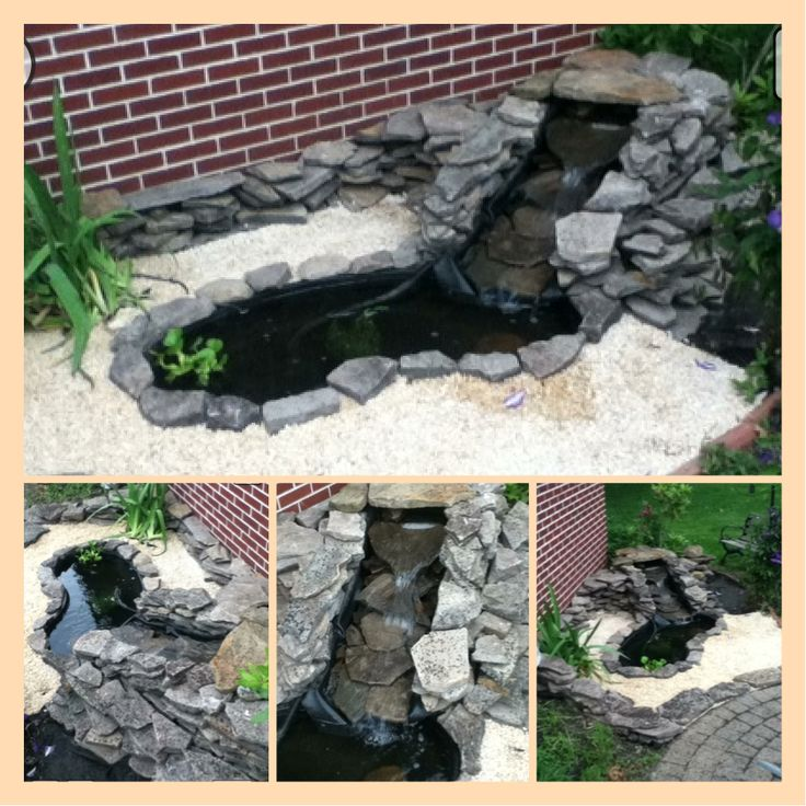 Small garden fish pond with waterfall background