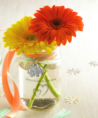For a fun wedding centerpiece use personalized mason jars