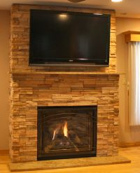 Ledgestone fireplace and tv setup | Bittern family room ...