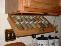 Under cabinet spice rack storage.