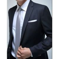 black suit, white shirt, silver tie