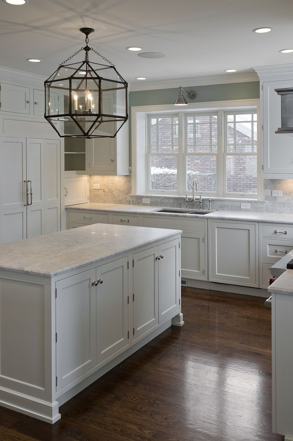 white kitchen cabinets with dark pulls white kitchen dark floors Dark floors