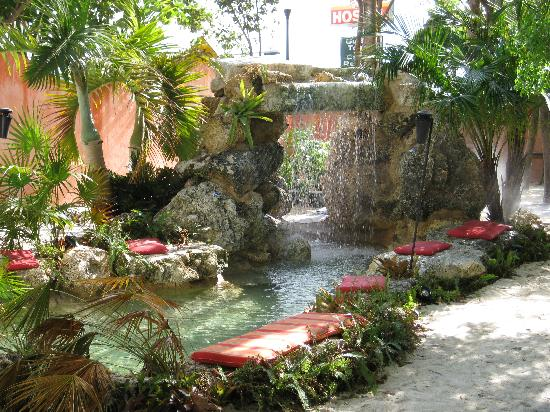 Wading pool with beach, cushions, and waterfall - Picture of
