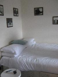 Double bed up against the wall - Picture of The Blue Boar ...