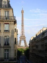 View of the Eiffel Tower from the love seat in the living ...
