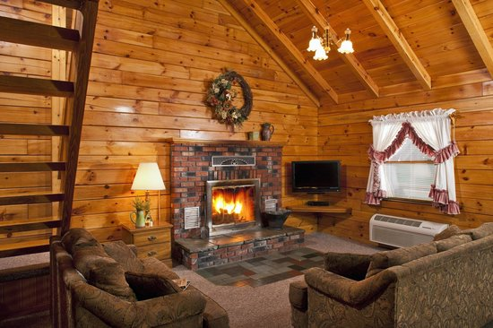 Family Log Cabin Living Room w\/real woodburning fireplace - log cabin living rooms