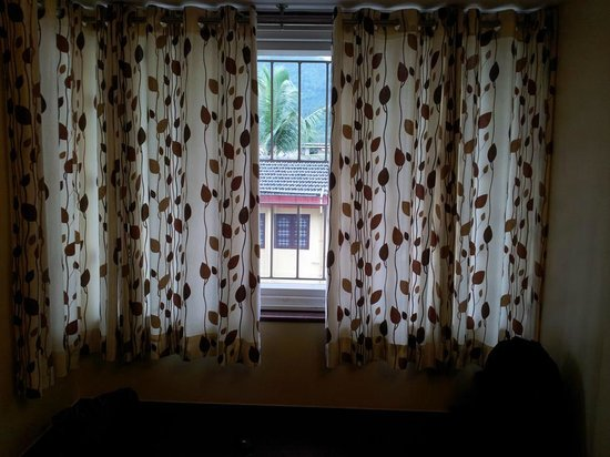 Basic Grill Windows With Curtains - Picture Of Hotel Mookambika