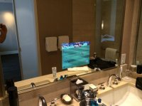 Bathroom with TV in the mirror! - Picture of Trump ...