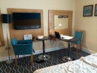 Work/sitting area, standing lamp, desk-top lap & TV in ...