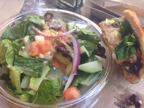 1/2 Greek salad with 1/2 Mediterranean sandwich Yum! - Picture of