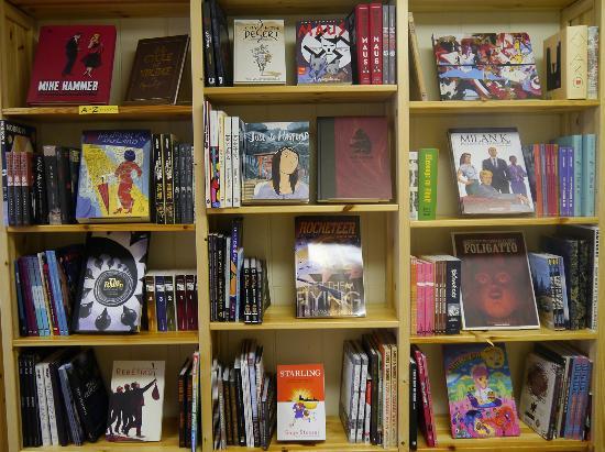 The Book Shelves Full Of Graphic Novels At Gnash Comics