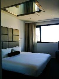 Bedroom with a mirror on the ceiling ;)