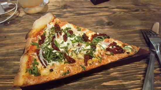 Yummy pizza slice served as appetizer; perfect size to share
