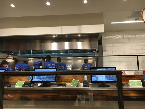 order counter and busy food prep/cook staff - Picture of honeygrow