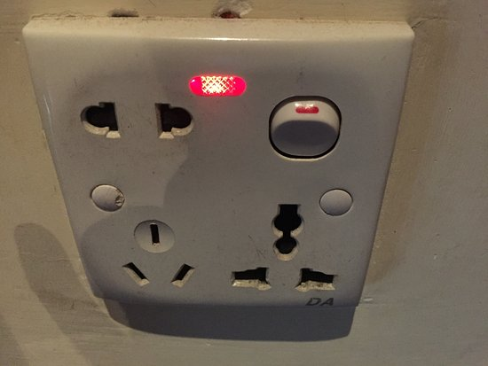 Clever power points take all types - Picture of Aureum Palace Hotel - types of power points