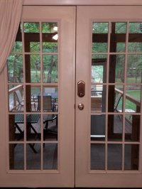 French doors off living room leading to screened in hot ...
