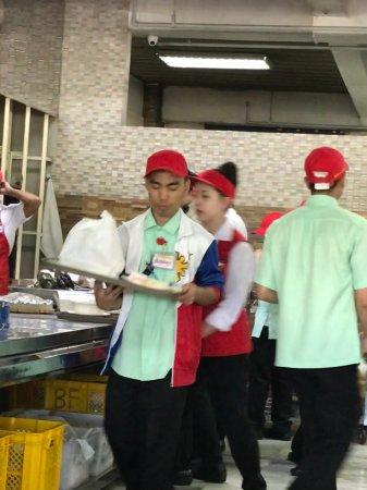 Food servers in action - Picture of Good Taste Cafe  Restaurant