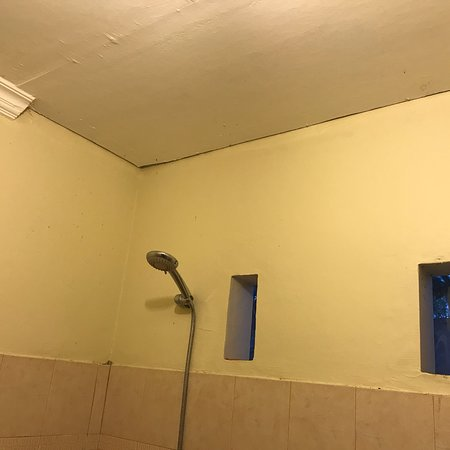 Rm108 1 light; wiring on wall surface; coving down in shower room +