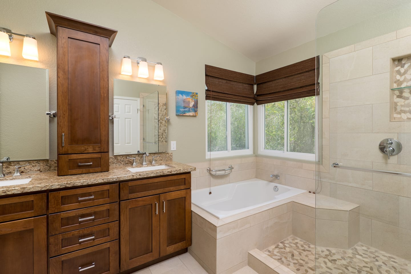 Remodeled bathroom with cabinets tile and tub